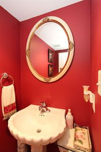 Powder room behind the kitchen...like red?