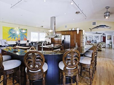 Bradenton estate rental - Cook's kitchen and bar. Casa Encantada features an open living area.