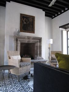 Formal living room with antique fireplace, custom furniture and artwork