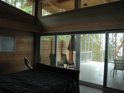 Master bedroom and its deck.. bed is on wheels, so that it can be rolled outside