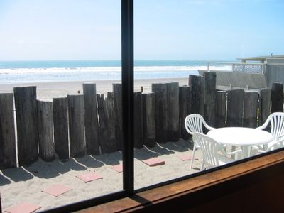 Private area with outside table for fresh air dining & easy beach access.
