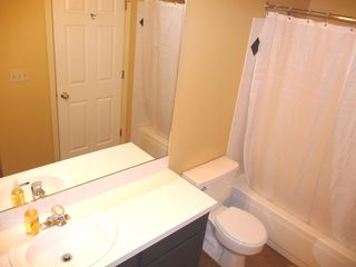 Twin Lakes condo photo - 2nd bathroom with tub shower, lots of storage, and hairdryer for guest use.