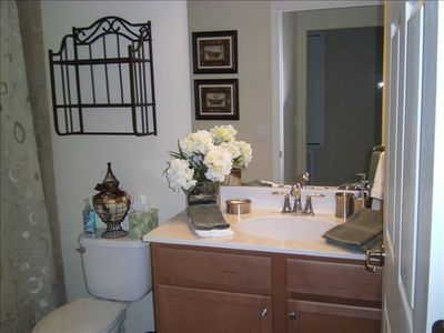 Guest Bathroom with one piece tub and shower