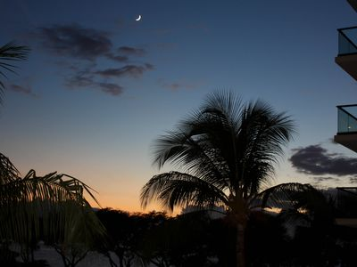 Honokowai condo rental - Sunset and moonrise from the lanai.