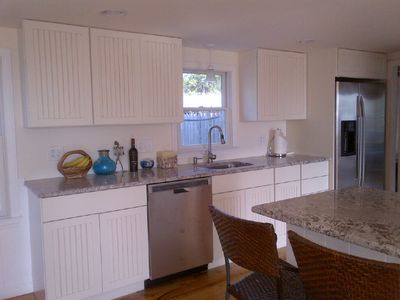 All new cabinets, appliances and granite kitchen; windows with water view behind