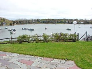 Orleans house photo - Enjoy panoramic views of saltwater Meeting House Pond from your patio!