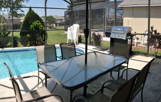 Emerald Island house photo - Patio Furniture and BBQ gas grill!