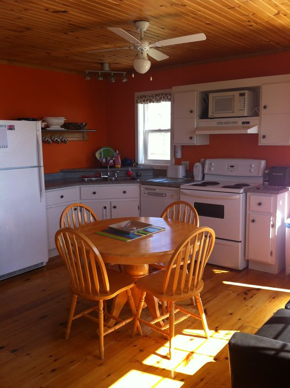 Kitchen ~ table opens up to easily seat 6. Small open kitchen fully equipped.