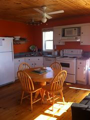 Darnley cottage photo - Kitchen ~ table opens up to easily seat 6. Small open kitchen fully equipped.