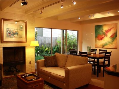 Living Room/Dining Room w/ original artworks. Wireless Internet throughout.