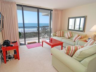 Family room with sliding doors to the balcony - Windy Hill condo vacation rental photo