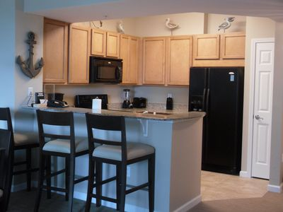 Fully furnished kitchen with pantry and full sized stove, oven, and dishwasher