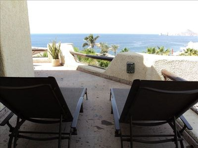 Patio lounge chairs with Land's End view.