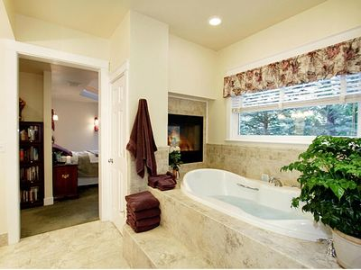 Luxuriate in the master bath with spa tub, sauna, fireplace and heated floor!
