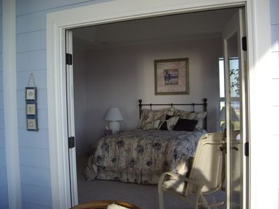 French doors open the master bedroom to the porch. Privacy blinds on this door.