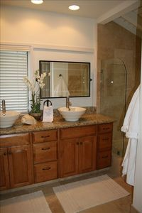 Master bathroom with large travertine sunken tub/shower and dual sinks
