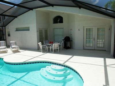 Villa pool with outside dining and gas barbecue