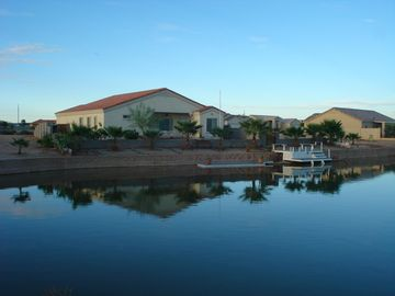 Casa Grande house rental - Rear view right on the lake.