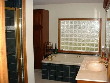 Relax in the wirlpool tub or large shower