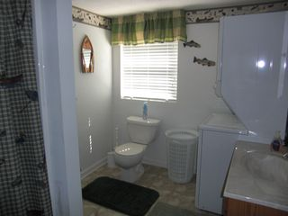 Goodview house photo - bathroom off TV room - tub and washer/dryer