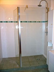Large shower and washbasin, toilets separated