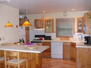 Sag Harbor house photo - Open kitchen with window, counter seating for 4.