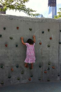 Fun in the neighborhood - my daughter climbing the rock wall in the park