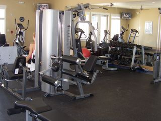 Galveston condo photo - State of the art fitness room over looks the pool and beach.