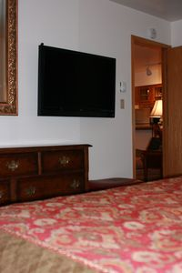 "Master bedroom with 46"" LED TV."