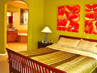 Master Bedroom Suite with King Sized Bed, Luxury Linens, and your own Bathroom