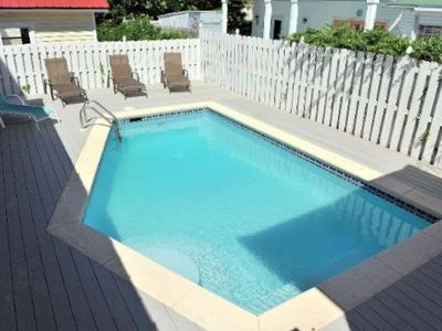 Private pool with composite decking, table w/umbrella & chairs and lounge chairs