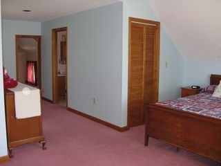 Weirs Beach house photo - Master bedroom with 3/4 bath and ceiling fan.