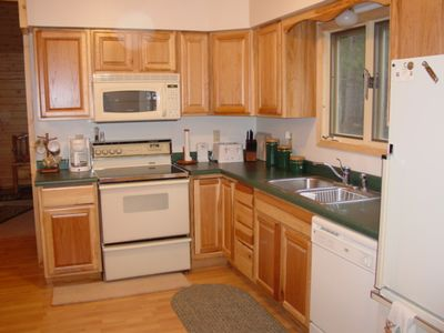 Kitchen features a microwave and dishwasher.