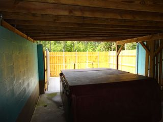 Privacy Fence and covered porch make the Hot Tub a private oasis - Gulfport house vacation rental photo