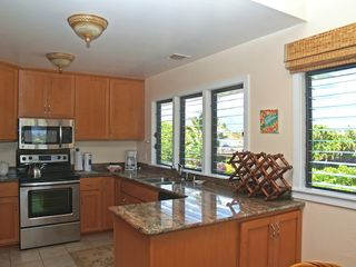 Poipu condo photo - Fabulous kitchen with lots of light and open windows to catch the breeze