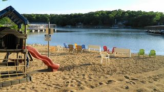 Osage Beach condo photo - The Ledges Sandy Beach Playground and Lake Swimming Area. The Kids Love it!