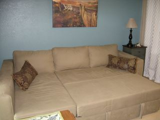 Oak Harbor condo photo - Our unique sectional converts to a comfortable queen sleeper on a study platform