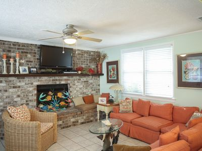 Beautiful brick fireplace and flatscreen TV in living area.