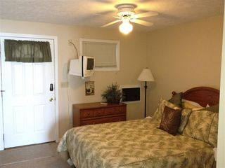 Onekama condo photo - Queen bed w/ tv
