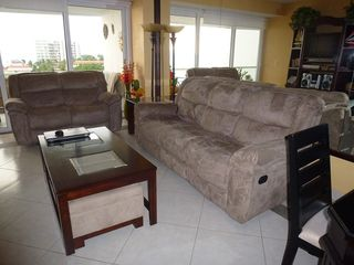 Nuevo Vallarta condo photo - Large living room with sofa and love seat. Both have recliners at the end.