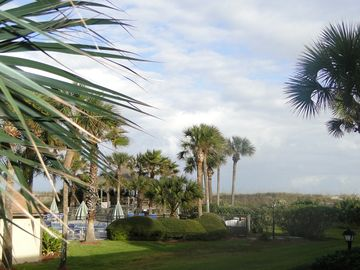 Picture from outdoor patio. Pool on left and beach just over the dune.
