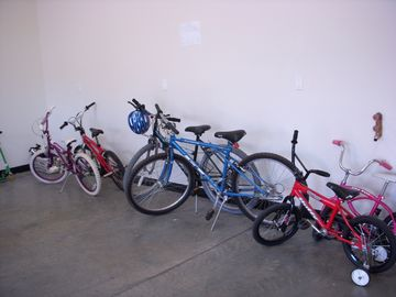 6 Adult and Kid Bikes + 3 ride ons for toddlers