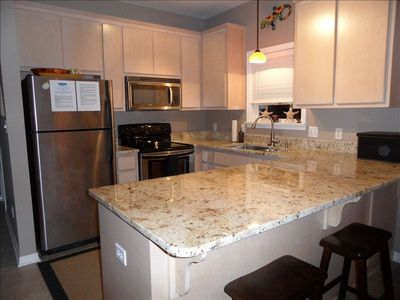 Recently upgraded kitchen...granite counter tops, commercial grade sink/faucet