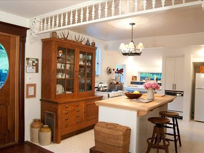 Unique country kitchen with butcher block  island and antique hutch/dishwasher