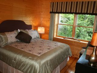 Pigeon Forge cabin photo - Stylish bedroom with king pillow-top matress. Each bedroom on their own level.