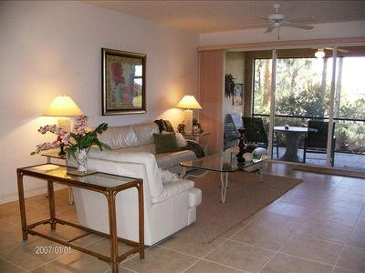 Luxurious Great Room leading to lanai & 9th Golf Green. Sun & Beach in