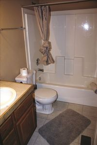 Upstairs Bathroom is located between the Family Room and Bedroom.