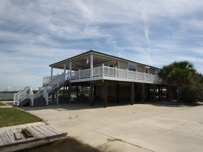 SPECtacular is a Waterfront 6 br w/ a lighted fishing pier and boat slips