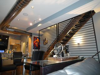 Open staircase to the third floor. - Phoenix townhome vacation rental photo