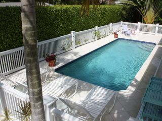 Old Naples house photo - Heated pool with fountains and in-pool seating and direct access to pool bath.